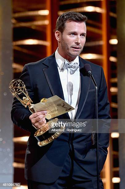 Actor Eric Martsolf accepts Outstanding Supporting Actor in a Drama Series for 'Days of Our Lives' onstage during The 41st Annual Daytime Emmy Awards...