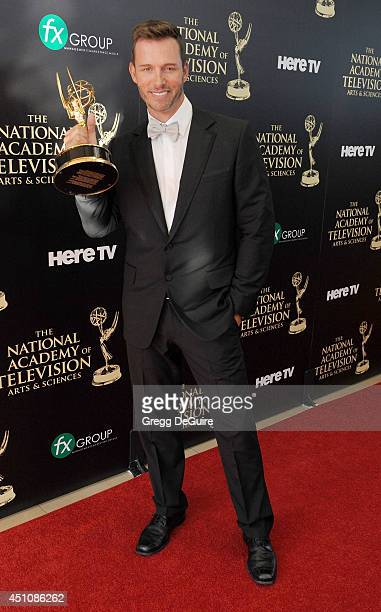 Actor Eric Martsolf poses in the press room at the 41st Annual Daytime Emmy Awards at The Beverly Hilton Hotel on June 22 2014 in Beverly Hills...