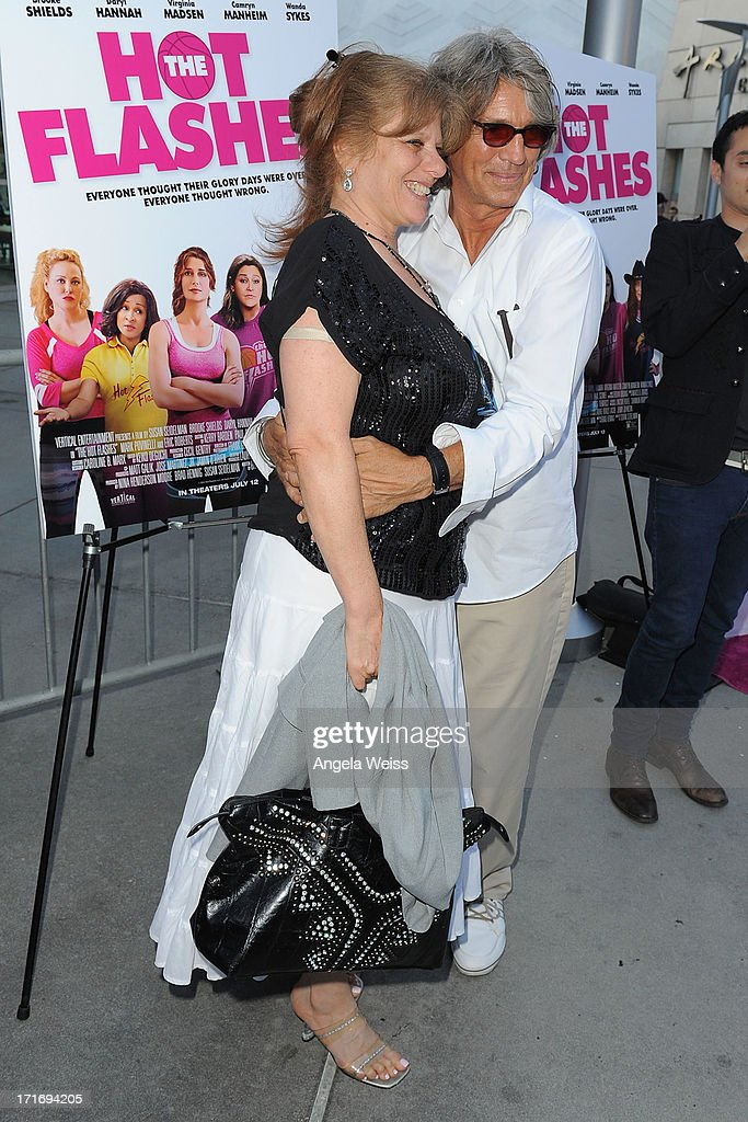 Actor <a gi-track='captionPersonalityLinkClicked' href=/galleries/search?phrase=Eric+Roberts&family=editorial&specificpeople=224670 ng-click='$event.stopPropagation()'>Eric Roberts</a> (R) and <a gi-track='captionPersonalityLinkClicked' href=/galleries/search?phrase=Eliza+Roberts&family=editorial&specificpeople=695830 ng-click='$event.stopPropagation()'>Eliza Roberts</a> arrive at the premiere of 'The Hot Flashes' at ArcLight Cinemas on June 27, 2013 in Hollywood, California.
