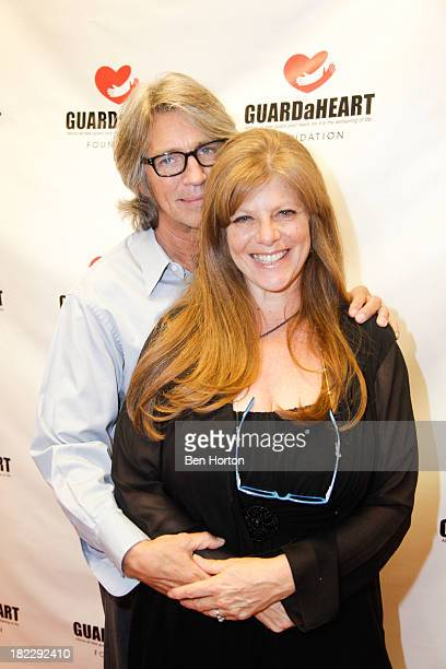 Actor Eric Roberts and his wife Eliza Roberts attend the GUARDaHEART Foundation World Heart Day 2013 celebration gala on September 28 2013 in Santa...