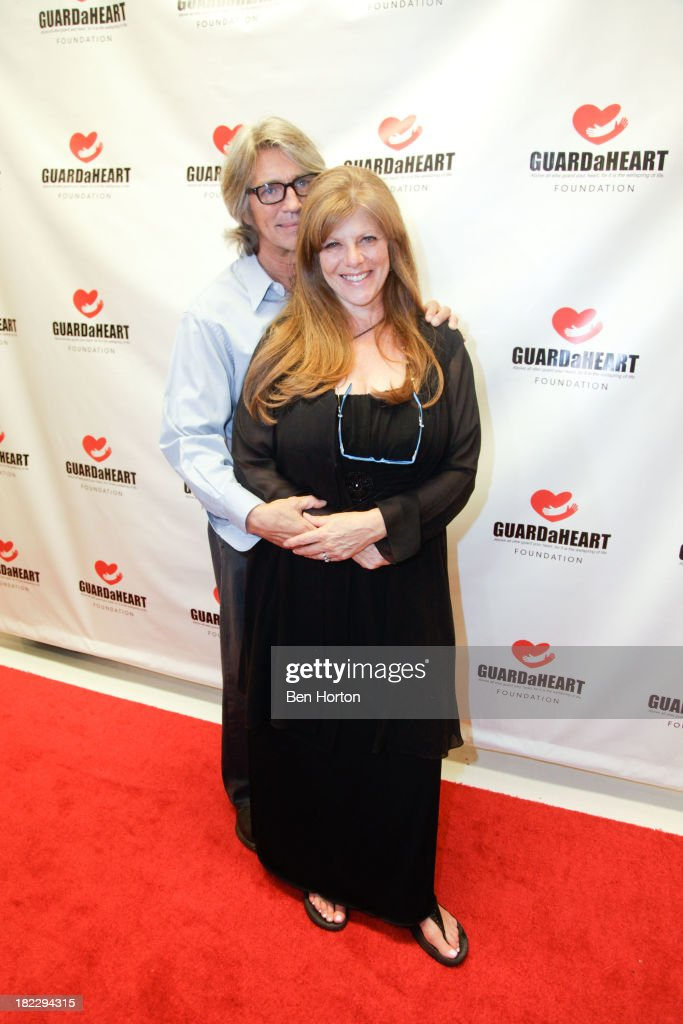Actor <a gi-track='captionPersonalityLinkClicked' href=/galleries/search?phrase=Eric+Roberts&family=editorial&specificpeople=224670 ng-click='$event.stopPropagation()'>Eric Roberts</a> and his wife <a gi-track='captionPersonalityLinkClicked' href=/galleries/search?phrase=Eliza+Roberts&family=editorial&specificpeople=695830 ng-click='$event.stopPropagation()'>Eliza Roberts</a> attend the GUARDaHEART Foundation World Heart Day 2013 celebration gala on September 28, 2013 in Santa Ana, California.