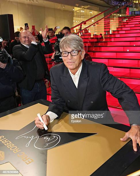 Actor Eric Roberts signs on his star during a ceremony honoring him with a star during 5th Russian International Horror Film Awards 'KAPLYA' at Vegas...