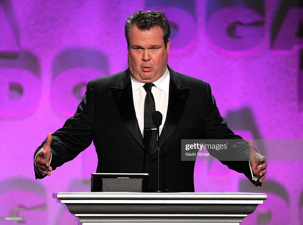 Actor Eric Stonestreet accepts Outstanding Directorial Achievement in Musical Variety award for the 66th Annual Tony Awards on behalf of director Glenn Weiss (not present) onstage during the 65th Annual Directors Guild Of America Awards at Ray Dolby Ballroom at Hollywood & Highland on February 2, 2013 in Los Angeles, California.