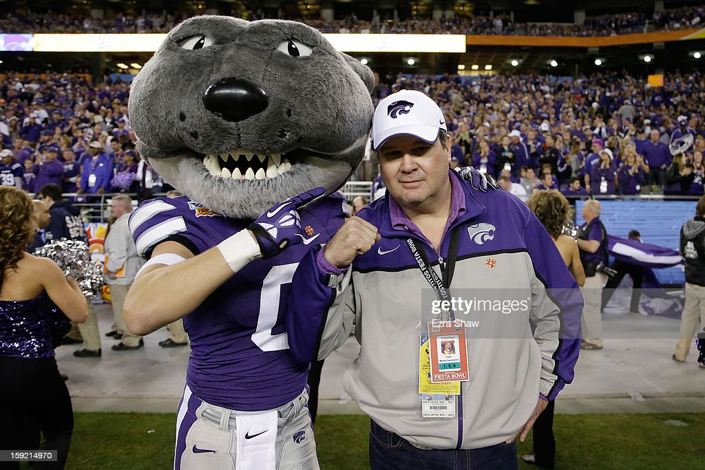 Actor Eric Stonestreet of Modern Family poses with the Kansas State Wildcat mascot during the Tostitos Fiesta Bowl at University of Phoenix Stadium on January 3, 2013 in Glendale, Arizona.