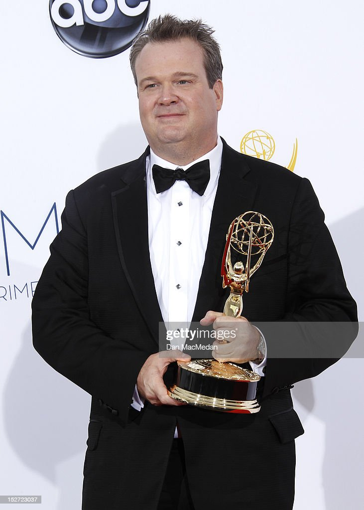 Actor <a gi-track='captionPersonalityLinkClicked' href=/galleries/search?phrase=Eric+Stonestreet&family=editorial&specificpeople=6129010 ng-click='$event.stopPropagation()'>Eric Stonestreet</a> poses in the press room at the 64th Primetime Emmy Awards held at Nokia Theatre L.A. Live on September 23, 2012 in Los Angeles, California.