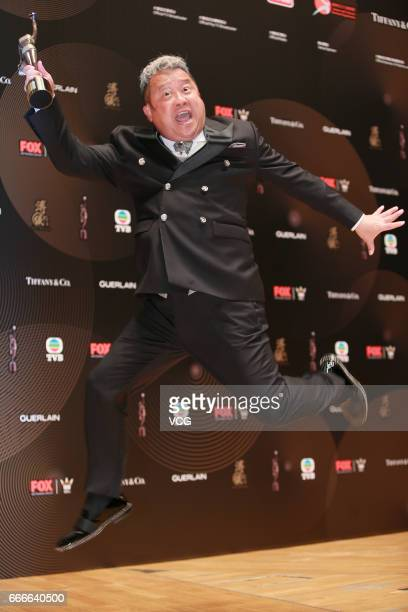 Actor Eric Tsang winner of Best Supporting Actor award for film 'Mad World' celebrates at the backstage of the 36th Hong Kong Film Awards at Hong...