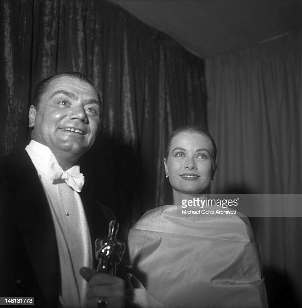 Actor Ernest Borgnine and actress Grace Kelly backstage at the Academy Awards ceremony after presenting him with the Oscar for Best Actor in a...