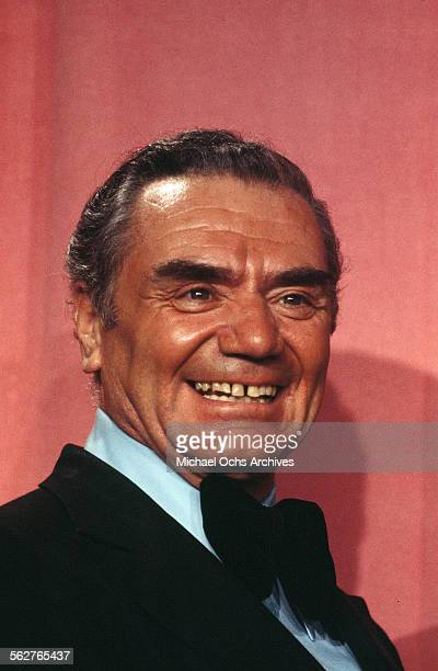 Actor Ernest Borgnine poses backstage after presenting 'Best Supporting Actor' award during the 46th Academy Awards at Dorothy Chandler Pavilion in...