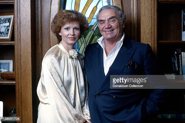Actor Ernest Borgnine poses for a portrait with his wife Tova Traesnaes Borgnine at their home in circa 1980 in Los Angeles California
