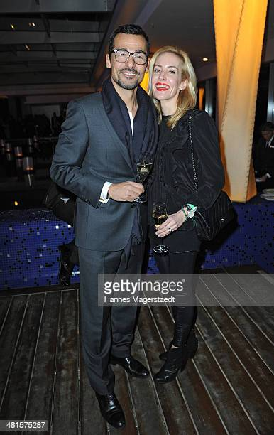Actor Erol Sander and his wife Caroline Sander attend the roof garden opening at Hotel Bayerischer Hof on January 9 2014 in Munich Germany