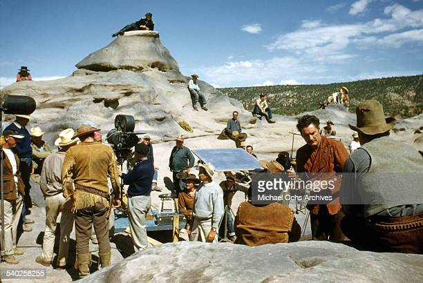 Actor Errol Flynn gets ready as a film crew films the movie 'Rocky Mountain' on location in Gallop New Mexico Starring Errol Flynn and Patrice Wymore