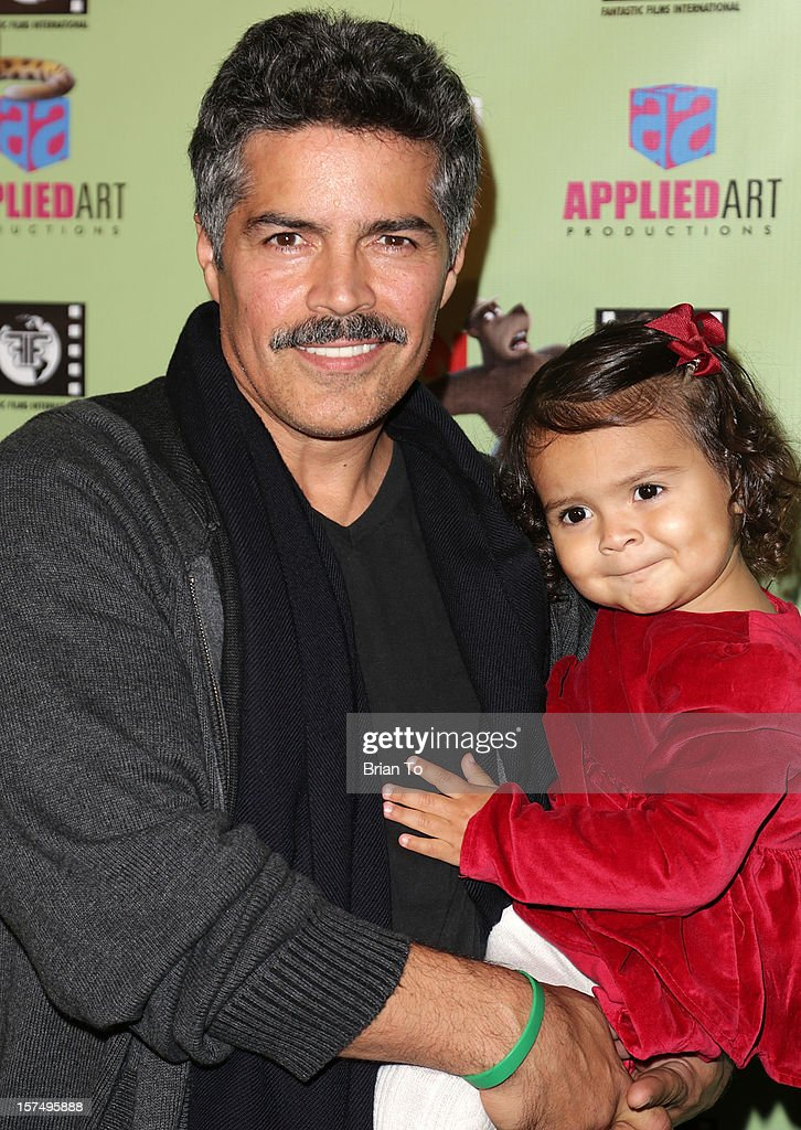 Actor <a gi-track='captionPersonalityLinkClicked' href=/galleries/search?phrase=Esai+Morales&family=editorial&specificpeople=208672 ng-click='$event.stopPropagation()'>Esai Morales</a> and daughter Mariana Oliveira Morales attend the 'Delhi Safari' Los Angeles premiere at Pacific Theatre at The Grove on December 3, 2012 in Los Angeles, California.