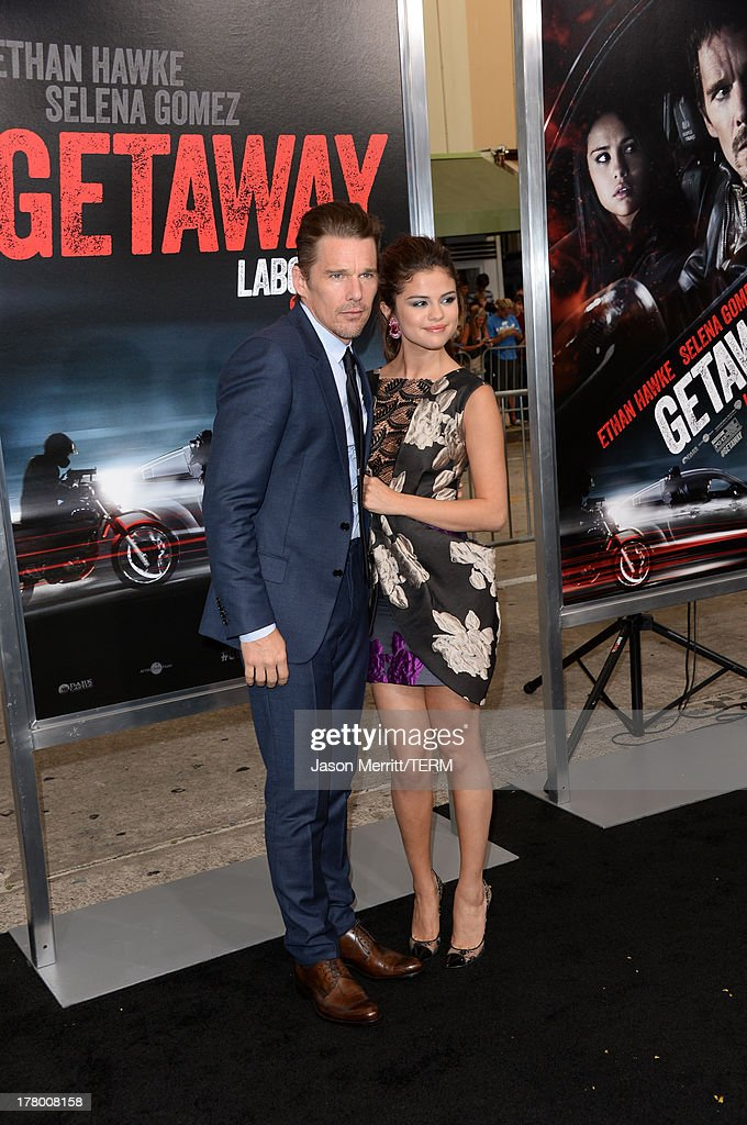 Actor Ethan Hawke and actress/singer Selena Gomez attend the premiere of 'Getaway' presented by Warner Bros. Pictures at Regency Village Theatre on August 26, 2013 in Westwood, California.