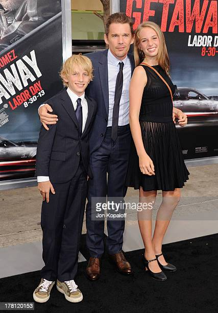 Actor Ethan Hawke and son Roan ThurmanHawke and daughter Maya ThurmanHawke arrive at the Los Angeles Premiere 'Getaway' at Regency Village Theatre on...