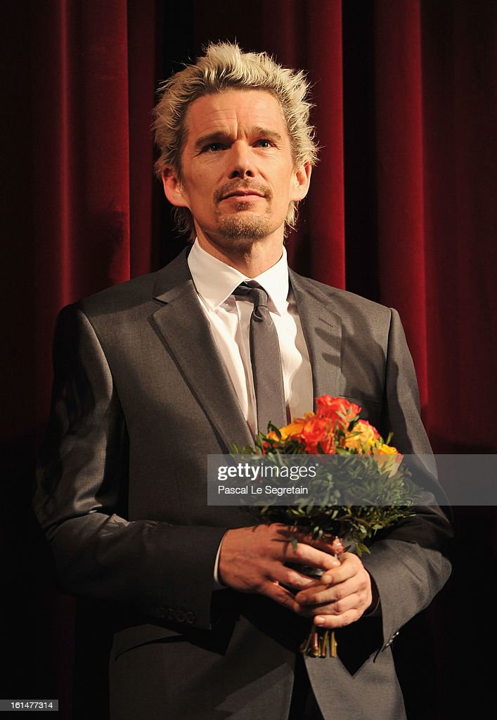 Actor <a gi-track='captionPersonalityLinkClicked' href=/galleries/search?phrase=Ethan+Hawke&family=editorial&specificpeople=178274 ng-click='$event.stopPropagation()'>Ethan Hawke</a> appears on stage after the 'Before Midnight' Premiere during the 63rd Berlinale International Film Festival at the Berlinale Palast on February 11, 2013 in Berlin, Germany.