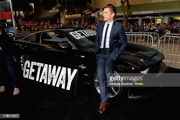 Actor Ethan Hawke arrives at the global 'Getaway' movie premiere featuring the Shelby GT500 Super Snake on the red carpet at Regency Village Theatre...