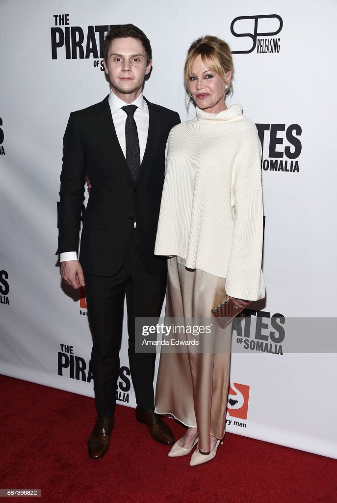 Actor Evan Peters (L) and actress Melanie Griffith arrive at the premiere of Front Row Filmed Entertainment's 'The Pirates Of Somalia' at the TCL Chinese 6 Theatres on December 6, 2017 in Hollywood, California.