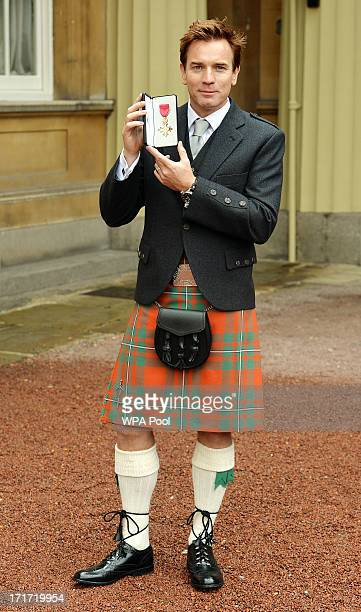 Actor Ewan McGregor holds his OBE after he received the award from Prince Charles Prince of Wales during an Investiture ceremony at Buckingham Palace...