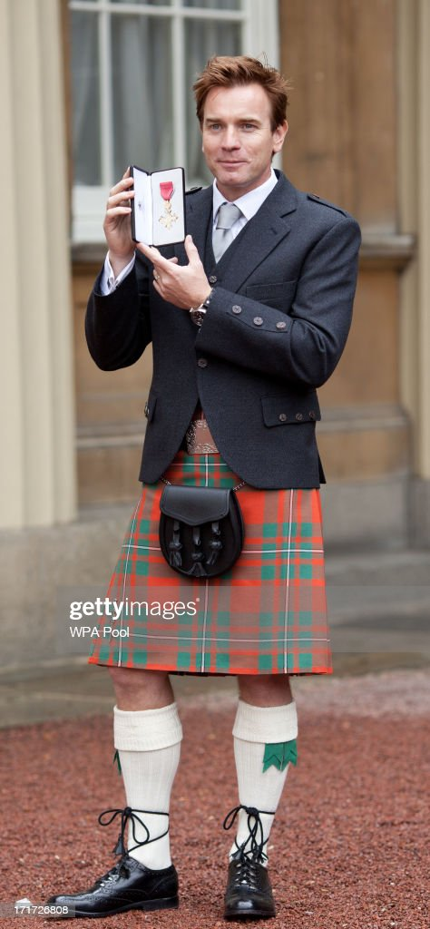 Actor Ewan McGregor holds his OBE for services to Drama and Charity after he received the award from Prince Charles, Prince of Wales during an Investiture ceremony at Buckingham Palace on June 28, 2013 in London, England. Mo Farah will receive an CBE for services to Athletics.