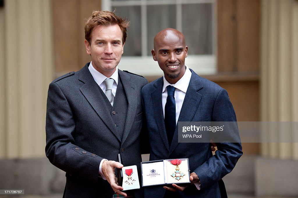 Actor <a gi-track='captionPersonalityLinkClicked' href=/galleries/search?phrase=Ewan+McGregor&family=editorial&specificpeople=202863 ng-click='$event.stopPropagation()'>Ewan McGregor</a> holds his OBE with Double Olympic Gold Medal winning athlete Mo Farrah as he holds his CBE after they received the awards from Prince Charles, Prince of Wales during an Investiture ceremony at Buckingham Palace on June 28, 2013 in London, England. Mo Farah will receive an CBE for services to Athletics.