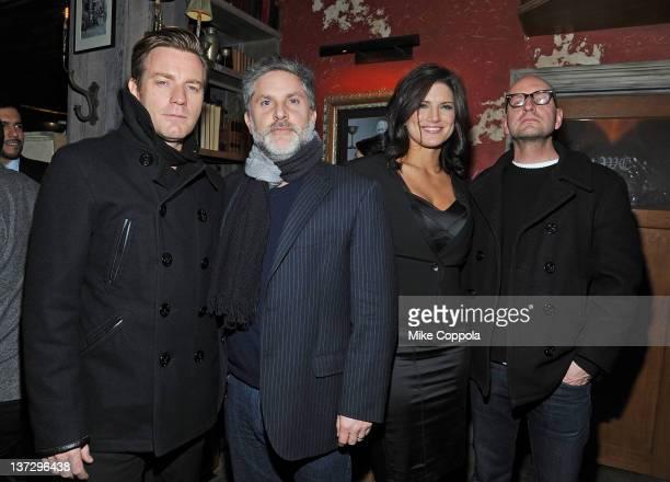Actor Ewan McGregor producer Gregory Jacobs actress Gina Carano and director Steven Soderbergh attend the Cinema Society Blackberry Bold screening...