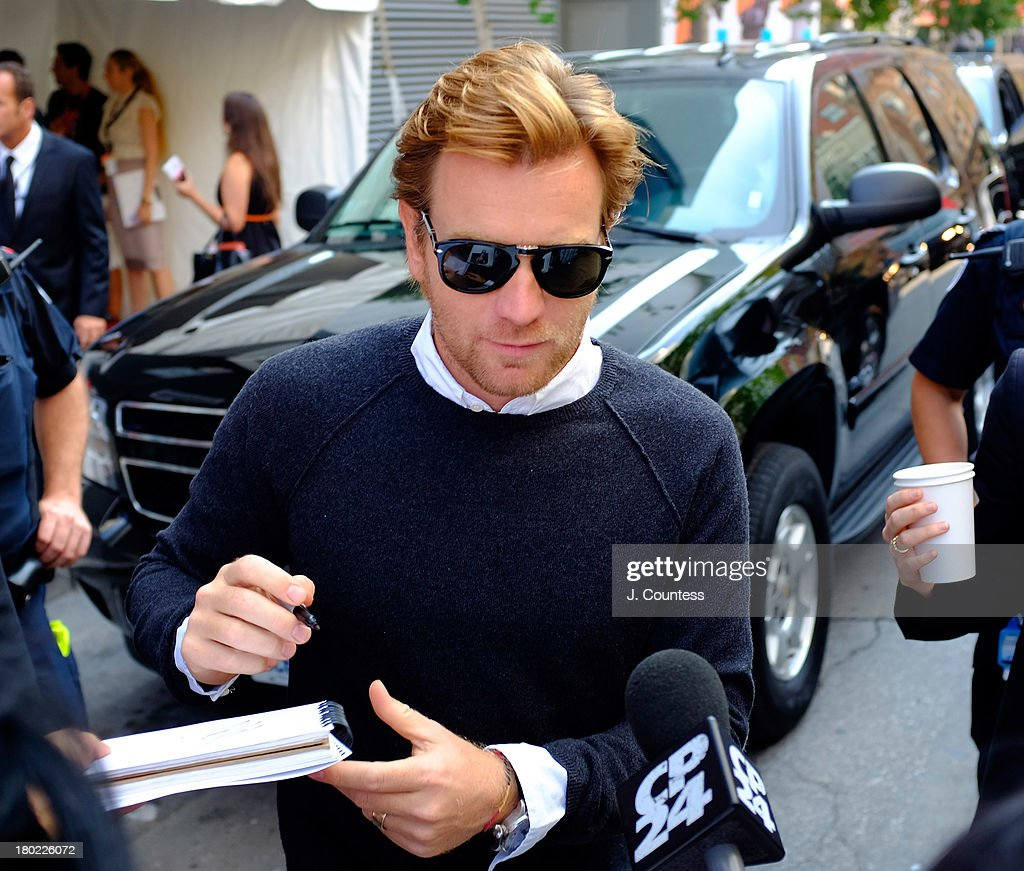 Actor <a gi-track='captionPersonalityLinkClicked' href=/galleries/search?phrase=Ewan+McGregor&family=editorial&specificpeople=202863 ng-click='$event.stopPropagation()'>Ewan McGregor</a> signs for fans following the press conference for August:Osage County during the Toronto Film Festival on September 9, 2013 in Toronto, Canada.