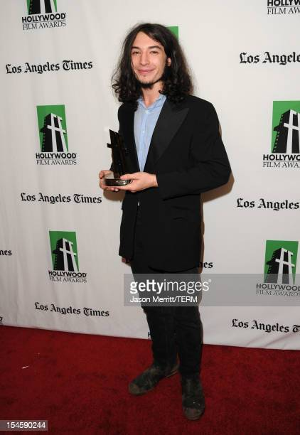 Actor Ezra Miller poses with the Hollywood Spotlight Award during the 16th Annual Hollywood Film Awards Gala presented by The Los Angeles Times held...