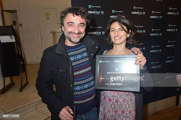 Actor Fabrice Feltzinger and 'Mobile Film Festival 2015' awarded screenwriter Fabienne Galula for the one minute mobile film 'jLe Carton...