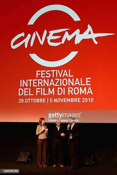 Actor Fabrizio Gifuni recieves the 3 Social Movie Star Award from Carolina Di Domenico and Stefano Piastrelli at the Collateral Awards ceremony...