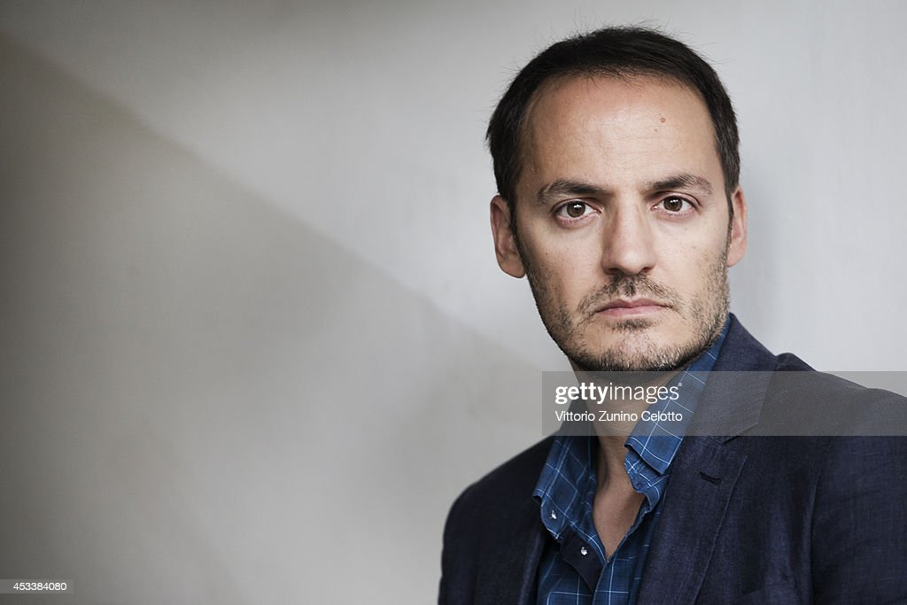 Actor <a gi-track='captionPersonalityLinkClicked' href=/galleries/search?phrase=Fabrizio+Rongione&family=editorial&specificpeople=5349599 ng-click='$event.stopPropagation()'>Fabrizio Rongione</a> poses on August 8, 2014 in Locarno, Switzerland.
