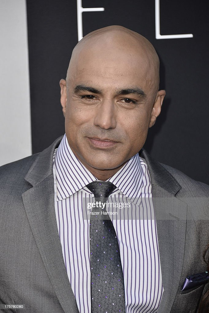 Actor Faran Tahir arrives at the premiere of TriStar Pictures' 'Elysium' at Regency Village Theatre on August 7, 2013 in Westwood, California.