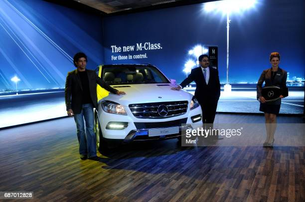 Actor Farhan Akhtar and Debashis Mitra Director marketing sales of mercedesbenz India photographed during Mercedes Bens launch of M class at the 11th...