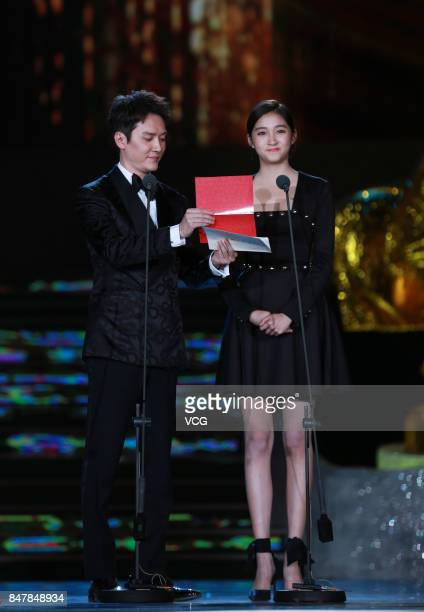 Actor Feng Shaofeng and actress Guan Xiaotong attend the 26th China Golden Rooster Hundred Flowers Film Festival on September 16 2017 in Huhhot Inner...
