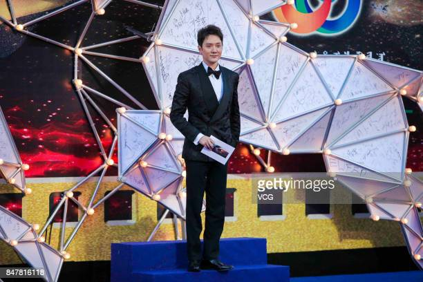 Actor Feng Shaofeng arrives at the red carpet of the closing ceremony of the 26th China Golden Rooster Hundred Flowers Film Festival on September 16...