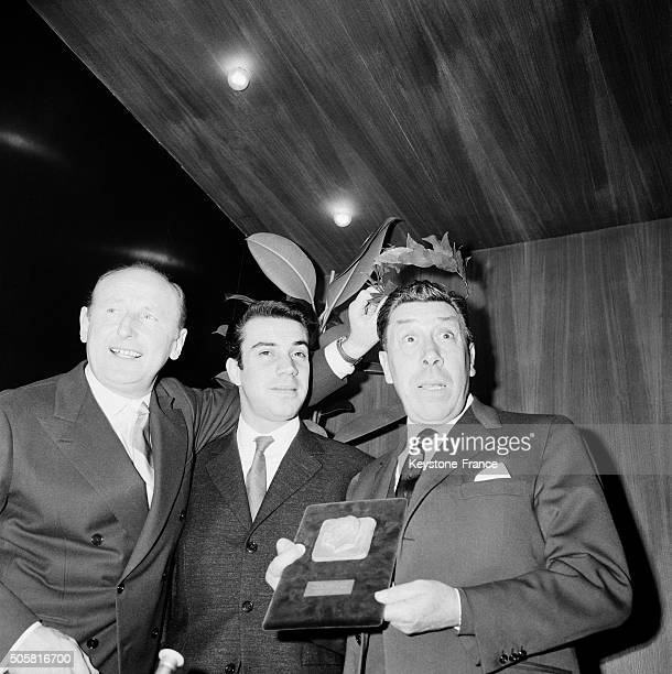 Actor Fernandel on the Right Receives The Medal Of The Grand Prix De L'Humour Cinématographique With His Son Franck And Actor Bourvil in Paris France...