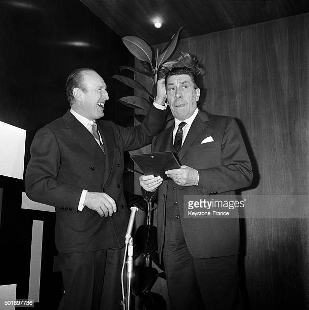 Actor Fernandel Receives The Prize Georges Courteline Or Prize Of Cinematographic Humour From Last Year Winner Actor Bourvil During A Lunch At the...