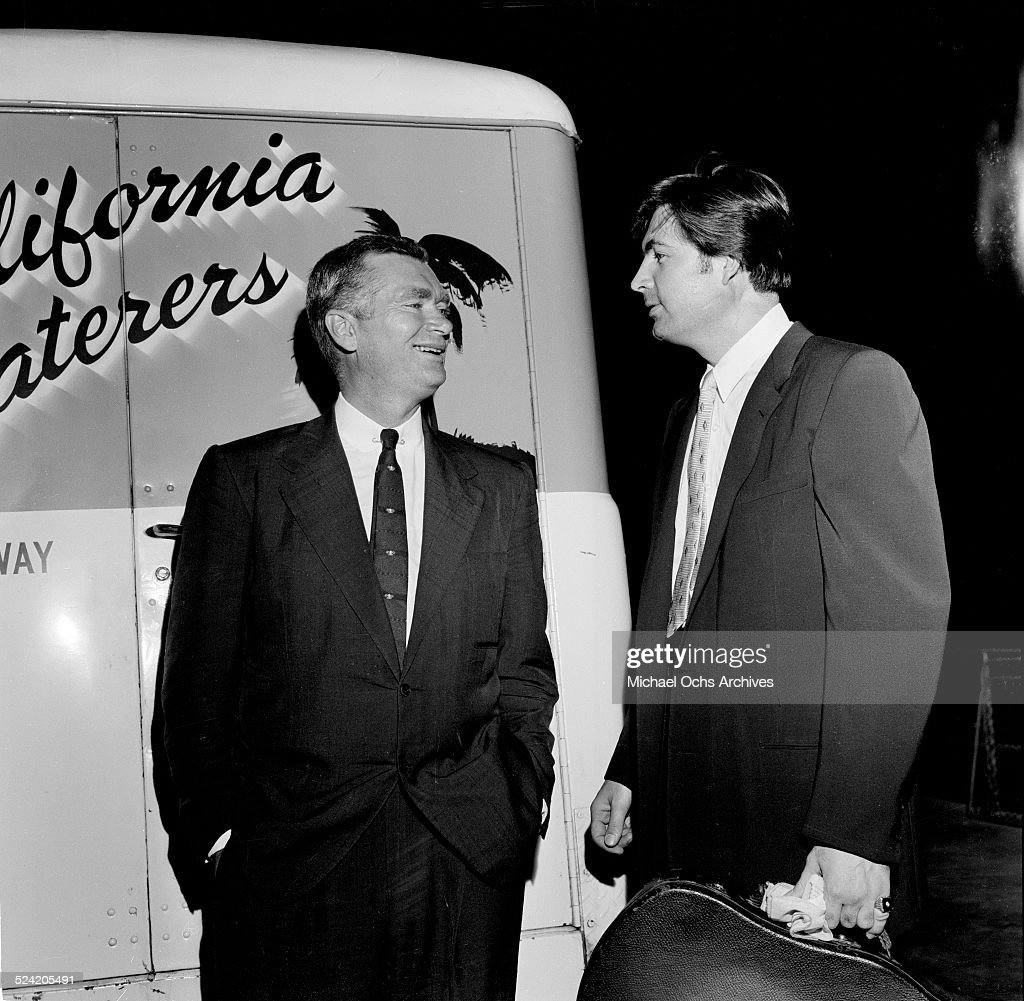 Actor <a gi-track='captionPersonalityLinkClicked' href=/galleries/search?phrase=Fess+Parker&family=editorial&specificpeople=989985 ng-click='$event.stopPropagation()'>Fess Parker</a> talks with actor <a gi-track='captionPersonalityLinkClicked' href=/galleries/search?phrase=Buddy+Ebsen&family=editorial&specificpeople=894081 ng-click='$event.stopPropagation()'>Buddy Ebsen</a> as he gets ready to sing at the Hollywood Bowl in Los Angeles,CA.