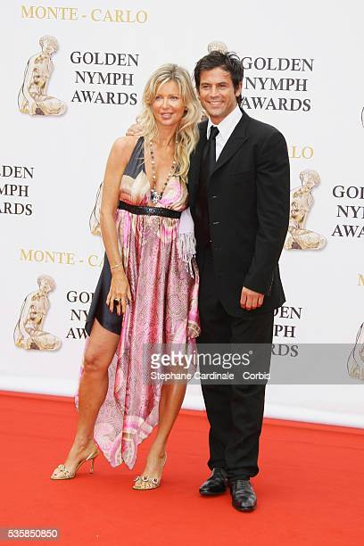 Actor Filip Nikolic arrives with his wife at the closing ceremony of the 47th annual Monte Carlo Television Festival held at Grimaldi Forum