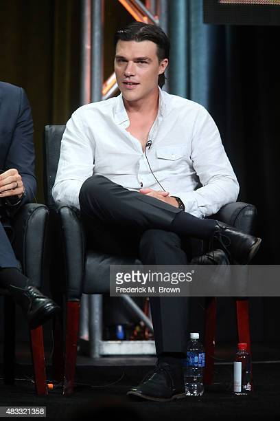 Actor Finn Wittrock speaks onstage during the 'AHS Hotel' panel discussion at the FX portion of the 2015 Summer TCA Tour at The Beverly Hilton Hotel...