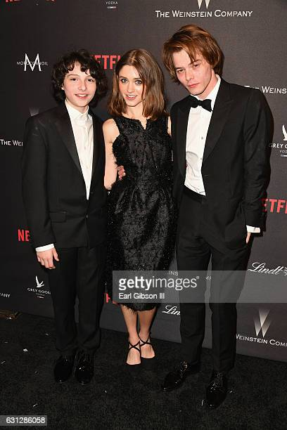 Actor Finn Wolfhard actress Natalia Dyer and actor Charlie Heaton attends The Weinstein Company and Netflix Golden Globe Party presented with FIJI...