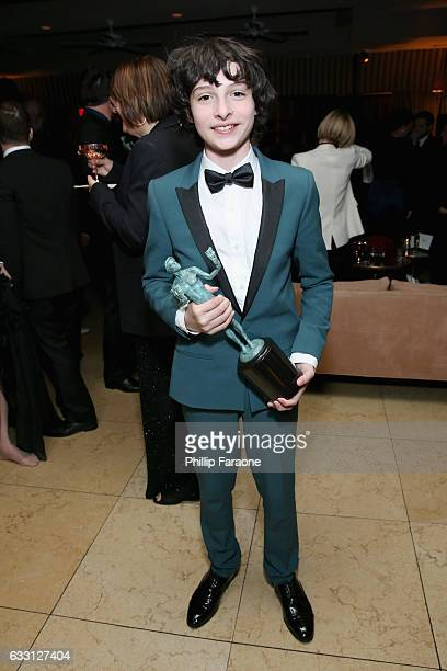 Actor Finn Wolfhard attends The Weinstein Company Netflix's 2017 SAG After Party in partnership with Absolut Elyx at Sunset Tower Hotel on January 29...