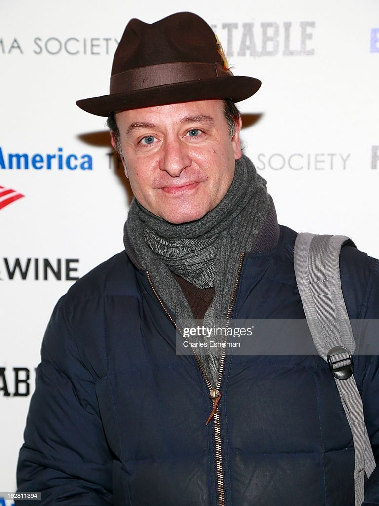 Actor Fisher Stevens arrives at Bank of America and Food & Wine with The Cinema Society present a screening of 'A Place at the Table' at the Celeste Bartos Theater at the Museum of Modern Art on February 27, 2013 in New York City.