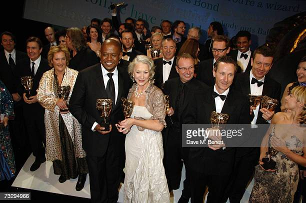 Actor Forest Whitaker and actress Helen Mirren pose with their Best Actor and Best Actress Award in the awards room along with the other winners at...