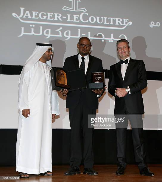 Actor Forest Whitaker is presented with his lifetime achievement award from Daniel Riedo and Ali AlJabri of Jaeger LeCoultre at the opening ceremony...