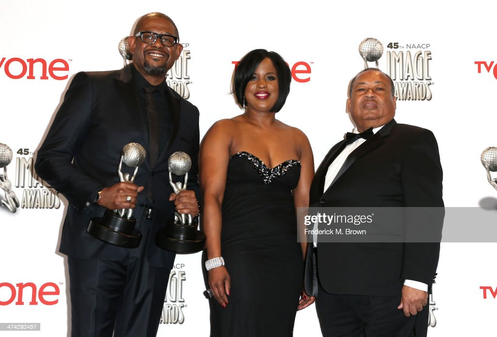 Actor <a gi-track='captionPersonalityLinkClicked' href=/galleries/search?phrase=Forest+Whitaker&family=editorial&specificpeople=226590 ng-click='$event.stopPropagation()'>Forest Whitaker</a>, winner of the Outstanding Actor in a Motion Picture award for 'Lee Daniels' The Butler' and the NAACP Chairman's Award, NAACP Board of Directors Chairman Roslyn Brock, and NAACP Board of Directors Vice Chairman <a gi-track='captionPersonalityLinkClicked' href=/galleries/search?phrase=Leon+Russell&family=editorial&specificpeople=2002652 ng-click='$event.stopPropagation()'>Leon Russell</a> pose in the press room during the 45th NAACP Image Awards presented by TV One at Pasadena Civic Auditorium on February 22, 2014 in Pasadena, California.