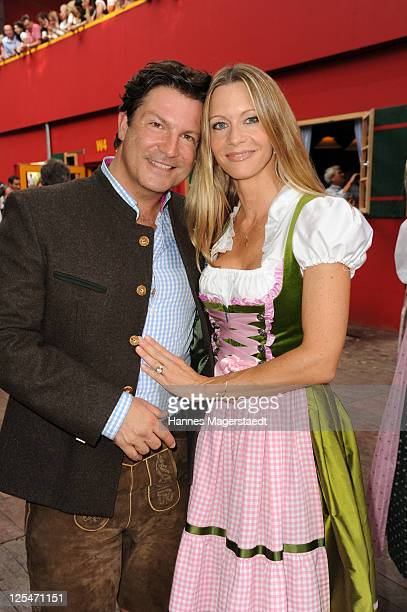 Actor Francis FultonSmith and his wife Verena Klein attend the Oktoberfest beer festival at Hippodrom beer tent on September 17 2011 in Munich Germany