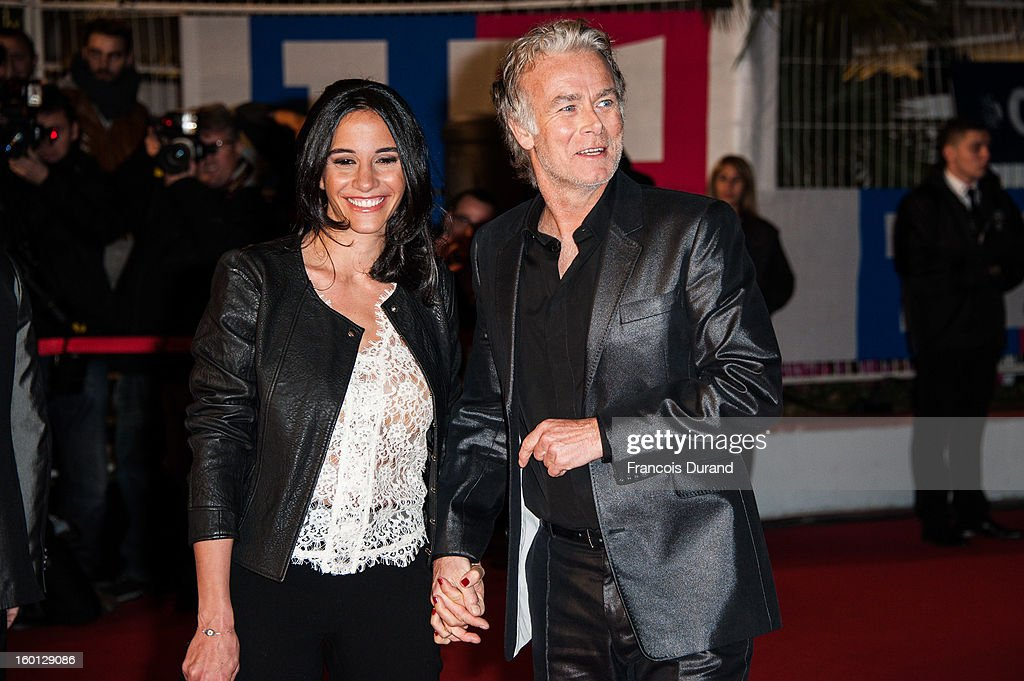 Actor <a gi-track='captionPersonalityLinkClicked' href=/galleries/search?phrase=Franck+Dubosc&family=editorial&specificpeople=609327 ng-click='$event.stopPropagation()'>Franck Dubosc</a> (R) and his wife Daniele attend the NRJ Music Awards 2013 at Palais des Festivals on January 26, 2013 in Cannes, France.