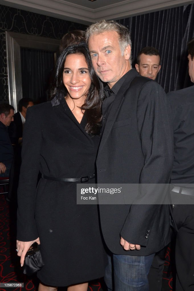Actor <a gi-track='captionPersonalityLinkClicked' href=/galleries/search?phrase=Franck+Dubosc&family=editorial&specificpeople=609327 ng-click='$event.stopPropagation()'>Franck Dubosc</a> and his wife Daniele attend the Russian New Year Dinner Party hosted by Smirnoff at the Castel Club on January 13, 2011 in Paris, France.