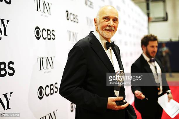 Actor Frank Langella poses in the press room with the award for Best Performance by an Actor in a Leading Role in a Play at the 70th Annual Tony...