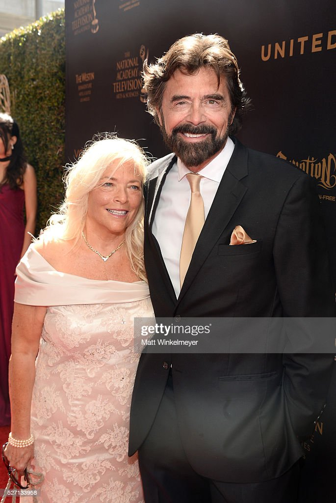 Actor Frank Runyeon and guest walk the red carpet at the 43rd Annual Daytime Emmy Awards at the Westin Bonaventure Hotel on May 1, 2016 in Los Angeles, California.
